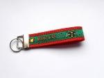 Agility grün-rot - ca. 11,5 cm zzgl. Metallöse und Schlüsselring