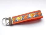 Dog-Poop orange - ca. 11,5 cm zzgl. Metallöse und Schlüsselring