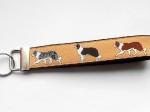 Border Collie beige (Gurtband schwarz) - ca. 15 cm zzgl. Metallöse und Schlüsselring